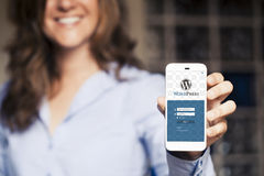 Wordpress mobile App in a smart phone screen. Royalty Free Stock Photo