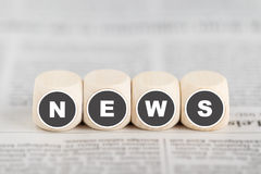 """The words """"news"""" on cubes Stock Photo"""