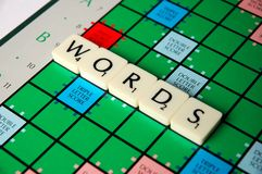 WORDS. Scrabble Board With Pieces Spelling WORDS Stock Photo