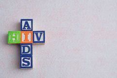 The words aids and hiv spelled with colorful blocks. Isolated on a white background stock photography