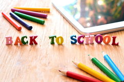 Words back to school made of wooden letters. Royalty Free Stock Photo