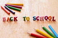 Words back to school made of wooden letters. Stock Photos