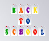 Words Back to school over gray Stock Photography