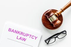 Words bankruptcy law written on the documents near judge gavel on white background top view space for text stock photo