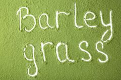 Words BARLEY GRASS. Made from green powder Royalty Free Stock Images