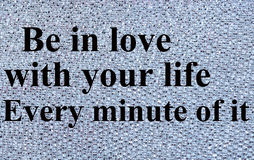 The words Be in love with your life. On silver background royalty free stock photography