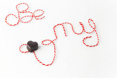 Words Be my valentine with chocolate heart Royalty Free Stock Photos