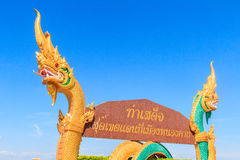 Words on the billboard Translated from Thai to English as  Tha. Beautiful Nagas on billboard. Words on the billboard Translated from Thai to English as  Tha Royalty Free Stock Photo