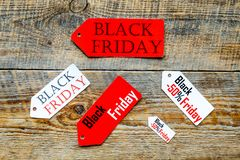 Words black friday on colored labels on wooden background top view Royalty Free Stock Photography