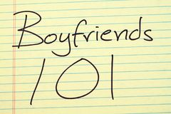 Boyfriends 101 On A Yellow Legal Pad. The words `Boyfriends 101` on a yellow legal pad stock photography