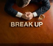 Words Break Up and devastated man composition Royalty Free Stock Images