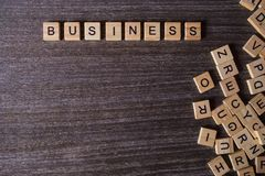 Words of business with collected of wooden blocks royalty free stock photography