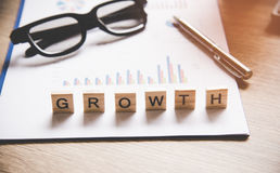 Words of business concepts collected in crossword. With wooden cubes Royalty Free Stock Photography