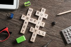 Conceptual business keywords on table with elements of game making crossword Royalty Free Stock Images