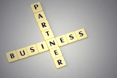 Words business and partner on a gray background Stock Photos