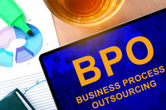 Words Business Process Outsourcing BPO on the tablet and charts. Royalty Free Stock Photo