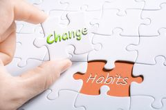 The Words Change And Habits In Missing Piece Jigsaw Puzzle. The Words Change And Habits In A Missing Piece Jigsaw Puzzle royalty free stock photos
