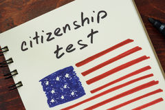 Words  citizenship test and American flag. Royalty Free Stock Photos