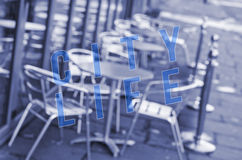 Words city life written on blurred out bar chairs and tables Stock Image