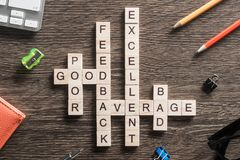 Conceptual media keywords on table with elements of game making crossword Stock Image