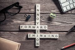 Conceptual media keywords on table with elements of game making Stock Photos