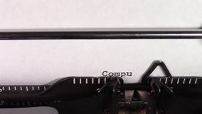 The words `Computers 101 ` being typed on a typewriter. A close up video of the words `Computers 101 ` being typed on white paper in an old manual typewriter stock footage