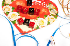 Words cubes over heart. And ribbons Royalty Free Stock Photography