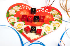 Words cubes over heart Royalty Free Stock Photography