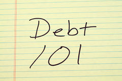 Debt 101 On A Yellow Legal Pad. The words `Debt 101` on a yellow legal pad Stock Photos