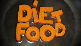 Words Diet Food collected from letters, which are carved from carrots stock video