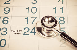Words doctor appointment written on a Calendar Stock Image