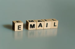 The words email written in cubes. On a grey background royalty free stock image