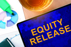 Words Equity Release  on the tablet and charts. Royalty Free Stock Image