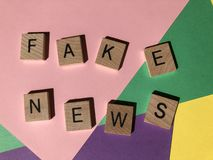The words Fake News, also known as  junk news or pseudo-news royalty free stock image