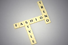 Words fashion, style and trend on a gray background Royalty Free Stock Photos