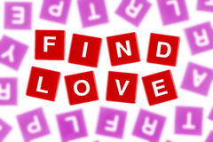 Words FIND LOVE in Clear Focus Against Blurred Letters Stock Photography