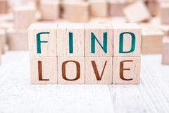 The Words Find Love Formed By Wooden Blocks On A White Table. The Words Find Love Formed By Wooden Blocks On White Table royalty free stock photos