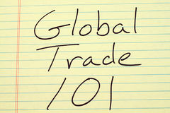 Global Trade 101 On A Yellow Legal Pad Royalty Free Stock Image