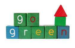 The words 'go green' with block house stock photos