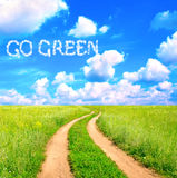 Words Go Green in the clouds Stock Image