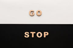 Words Go and Stop on contrast background Royalty Free Stock Images