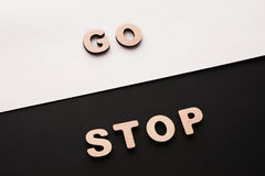 Words Go and Stop on contrast background. Start and finish, movement and standing concept Stock Photo