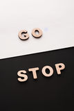 Words Go and Stop on contrast background. Start and finish, movement and standing concept Royalty Free Stock Photography