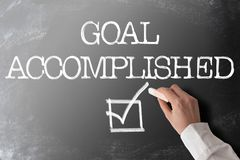 Words GOAL ACCOMPLISHED with checkmark on chalkboard. Words GOAL ACCOMPLISHED with checkmark on blackboard royalty free stock images