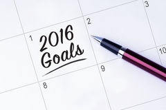 The words 2016 Goals on a calendar planner to remind you an impo royalty free stock images