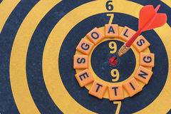 Words goals setting and dart target on bullseye Royalty Free Stock Photography