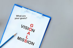 Words of goals, vision and mission on notepad Stock Photo