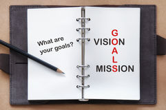Words of goals, vision and mission on organizer book with pencil Royalty Free Stock Photo