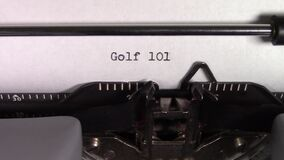 The words `Golf 101 ` being typed on a typewriter