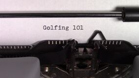 The words `Golfing 101 ` being typed on a typewriter